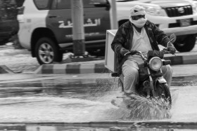 Photo Of The Week – Motorcycle in Ras al Khaimah UAE working its way through the flooded streets