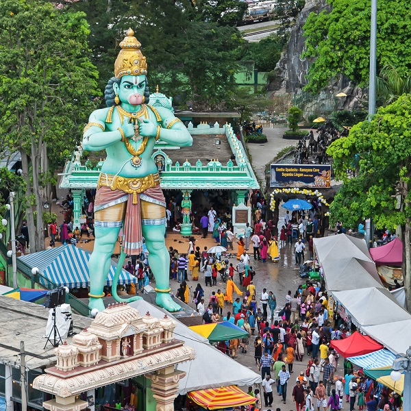 Statue and temple at Thaipusam Batu Caves