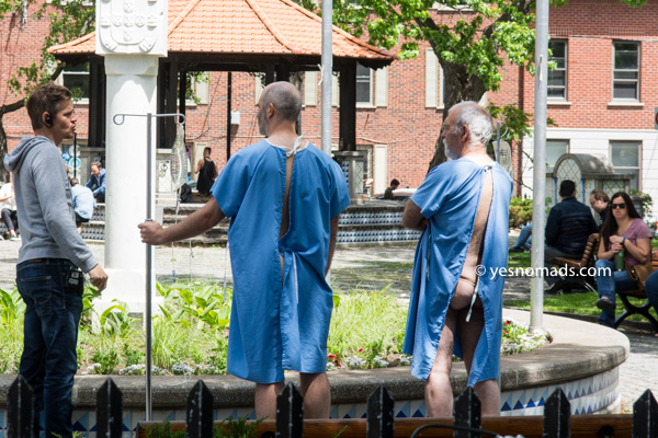 Men in hospital gowns at Parc du Portugal in Montreal